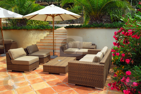 Patio of a villa stock photo, Patio of mediterranean villa in French Riviera with wicker furniture by Elena Elisseeva