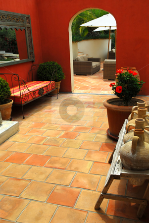 Courtyard of a villa stock photo, Courtyard of mediterranean villa in French Riviera. Shallow depths of filed, focus on amphoras. by Elena Elisseeva