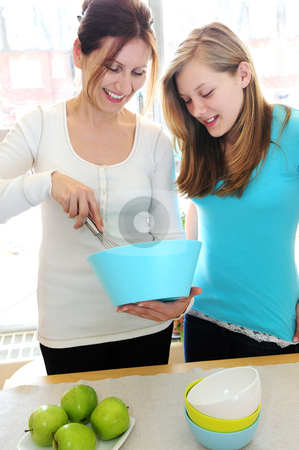 Mother and daughter cooking  stock photo, Mother and daughter cooking together at home by Elena Elisseeva