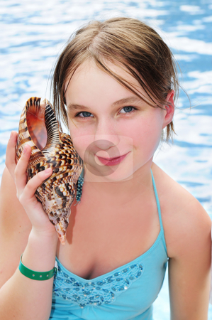 Young girl with seashell stock photo, Portrait of a teenage girl with large tropical seashell by Elena Elisseeva