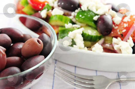 Olives and greek salad stock photo, Black kalamata olives and greek salad with feta cheese by Elena Elisseeva