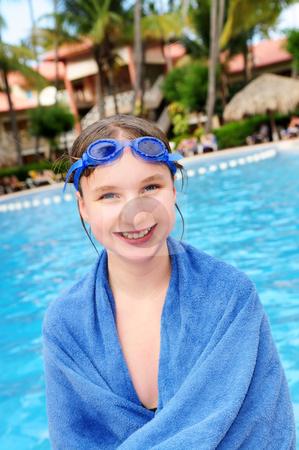 Teenage girl at swimming pool  stock photo, Teenage girl at the swimming pool in tropical resort by Elena Elisseeva