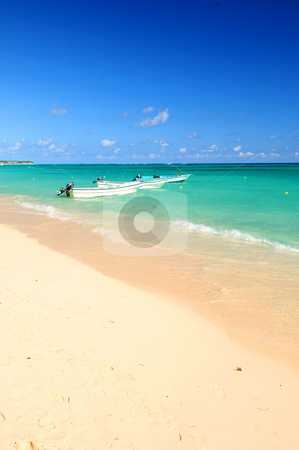 Fishing boats in Caribbean sea stock photo, Fishing boats in Caribbean sea anchored near sandy beach by Elena Elisseeva