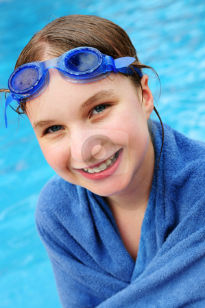 Teenage girl at swimming pool stock photo, Teenage girl at the swimming pool wrapped in blue towel by Elena Elisseeva