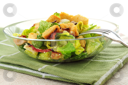 Caesar salad stock photo, Fresh caesar salad with croutons and bacon bits served in a glass bowl by Elena Elisseeva