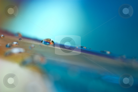 Abstract macro of water on a pool stock photo, Abstract macro of water droplets on a child's inflatable swimming pool by Vince Clements