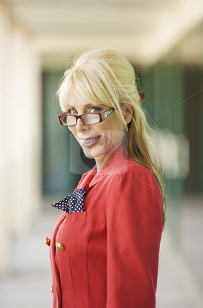 Modern Businesswoman stock photo, Modern Businesswoman in a Bright Red Suit by Scott Griessel