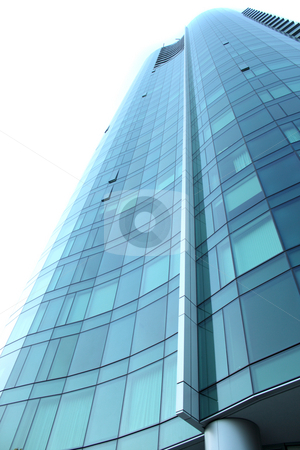 Office Building stock photo, Tall office building with blue glass windows by ImageZebra .