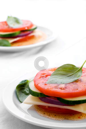 Garden vegetable stacks  stock photo, Garden vegetable stacks on white plates by Vince Clements