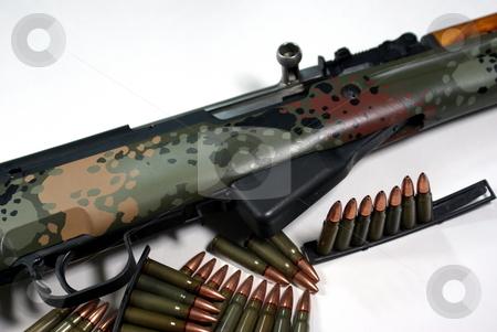 Military Rifle And Ammunition stock photo, An old military rifle with stripper clips of ammunition by Lynn Bendickson