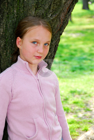 Girl and big tree stock photo, Young girl standing near ancient big tree by Elena Elisseeva
