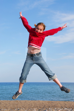 Girl jumping stock photo, Girl jumping on a beach by Elena Elisseeva