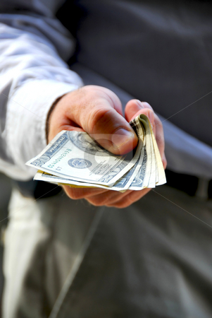 Hand offer money stock photo, Hand of a businessman offering money by Elena Elisseeva
