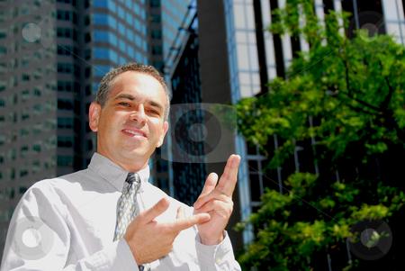 Businessman explaining stock photo, Confident smiling businessman explaining a concept by Elena Elisseeva