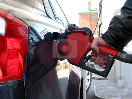 Gas pump fueling stock photo, Car being filled up with gas at gas pump by Elena Elisseeva