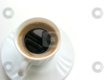 Cup of coffee 4 stock photo, Foamy espresso coffee in a white cup with saucer on white background, top view, space for copy by Elena Elisseeva