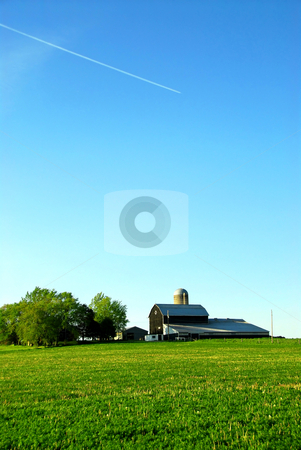Farmhouse and barn stock photo, Farmhouse and barn among green fields, vertical by Elena Elisseeva