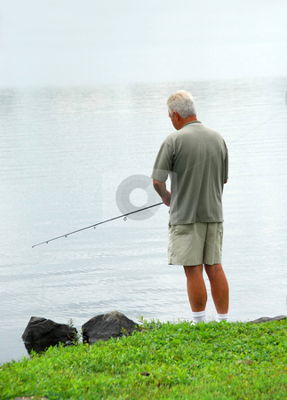 Man fishing stock photo, Senior man fishing in a lake by Elena Elisseeva