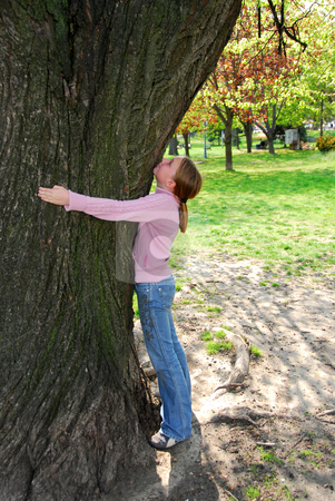Girl and big tree stock photo, Young girl standing near ancient big tree. Protect environment concept. by Elena Elisseeva