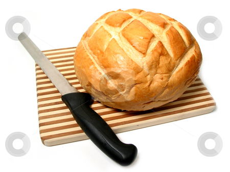 Bread and knife stock photo, Bread and knife on cutting board, white background by Elena Elisseeva