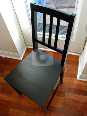 Black chair stock photo, Black chair on hardwood floor by Elena Elisseeva