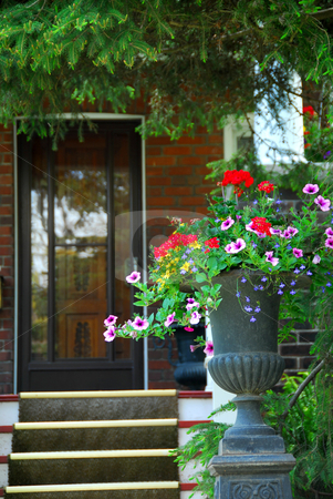 House entrance stock photo, House entrance with flower vase by Elena Elisseeva