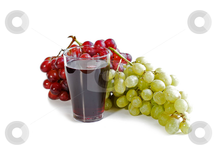 Grapes and juice stock photo, Red and green grapes with a glass of fruit juice by Elena Elisseeva