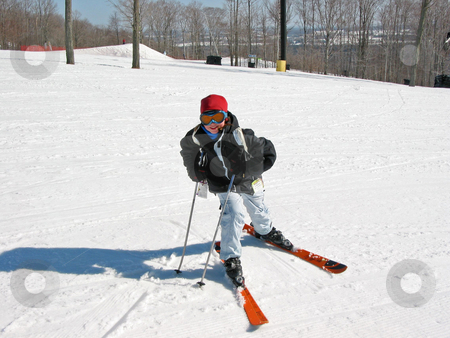 Girl child ski stock photo, Young girl on the slope of a downhill ski run by Elena Elisseeva