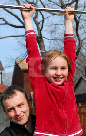 Father daughter fun stock photo, Father and daughter having fun in a backyard by Elena Elisseeva
