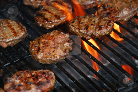 Hamburgers on barbeque stock photo, Hamburgers cooking on barbeque grill with flames by Elena Elisseeva