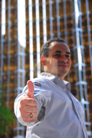 Businessman thumbs up stock photo, Confident businessman showing thumbs up, focus on a hand by Elena Elisseeva