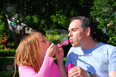 Family summer bubbles stock photo, Happy family blowing soap bubbles, father and child by Elena Elisseeva