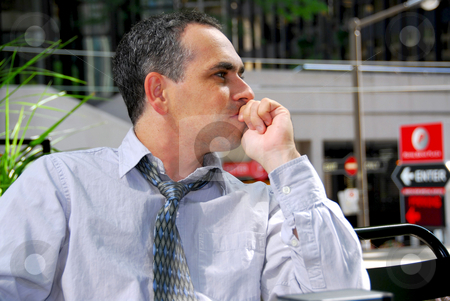 Businessman thinking stock photo, Businessman sitting in outdoor cafe thinking by Elena Elisseeva