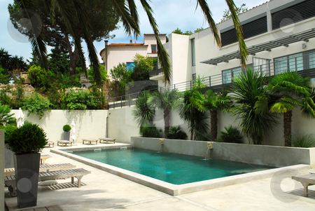 Swimming pool stock photo, Swimming pool of mediterranean villa in French Riviera by Elena Elisseeva