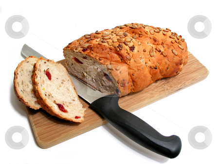 Bread knife board stock photo, Artisan pumkin seed and cranberry bread on a cutting board with a bread knife, white background by Elena Elisseeva