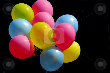 Colorful balloons on black stock photo, Colorful balloons on black background by Elena Elisseeva