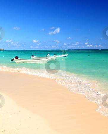 Fishing boats in Caribbean sea stock photo, Fishing boats in Caribbean sea anchored near sandy beach by Elena Elisseeva