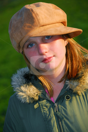 Girl portrait hat stock photo, Portrait of a young girl in a hat, evening sun by Elena Elisseeva