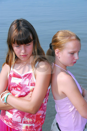 Two girls pouting stock photo, Two preteen girls pouting by Elena Elisseeva