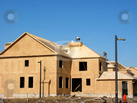 New home construction stock photo, Construction of a new house with workers on the roof by Elena Elisseeva