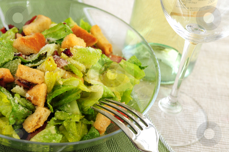 Caesar salad stock photo, Caesar salad served in a glass bowl and white wine by Elena Elisseeva