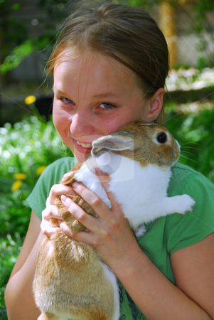 Girl and bunny stock photo, Pretty girl holding a bunny by Elena Elisseeva