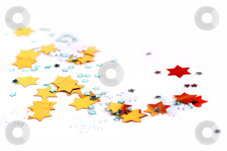 Christmas background stock photo, Christmas background of scattered gilittering confetti on white by Elena Elisseeva