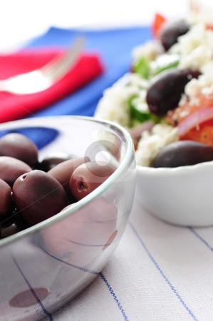 Olives and greek salad stock photo, Black kalamata olives and greek salad with feta cheese by Elena Elisseeva