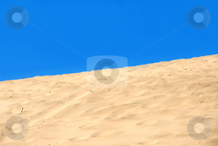 Sand dune stock photo, Background of a sand dune with clear blue sky by Elena Elisseeva
