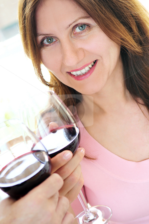 Mature woman toasting with red wine stock photo, Mature woman toasting with ...