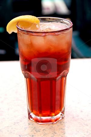 Iced tea stock photo, Glass of lemon iced tea with ice by Elena Elisseeva