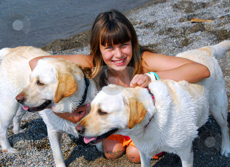Girl two dogs stock photo, Portrait of a young pretty girl with two dogs on a beach by Elena Elisseeva