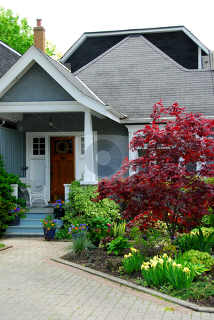 Cozy house stock photo, Cozy home with beautuful landscaping by Elena Elisseeva