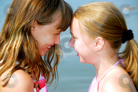 Two girlfriends stock photo, Portrait of two young happy girls by Elena Elisseeva
